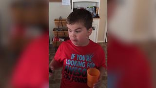 """Young Boy Challenges Himself with a Jalapeno Pepper"""