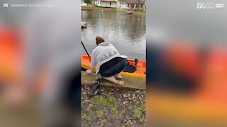Woman falls as she tries to get into kayak