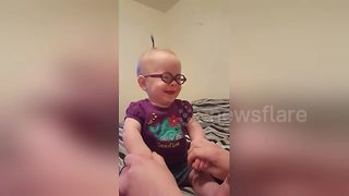 Baby is confused as she sees clearly for the first time - Video