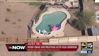 One-year-old pulled from pool in Phoenix - Video