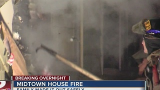 Family escapes overnight midtown house fire - Video
