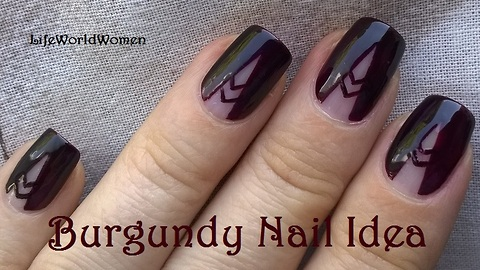 Burgundy negative space tale nail art