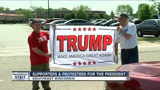Supporters and protesters came out in droves for presidential visit - Video