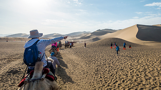 Riding Camels and Hang Gliders in the Gobi Desert China - Video