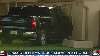 Pasco Deputy's truck slams into house - Video