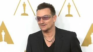 Bono has mid-air scare - Video
