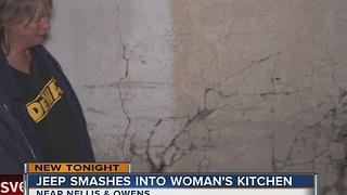 Driver of SUV smashes through woman's kitchen