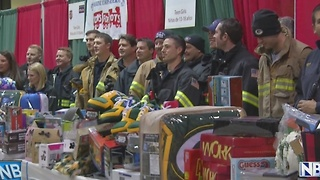 Green Bay firefighters break a donation record during their Gifts for Teens drive - Video