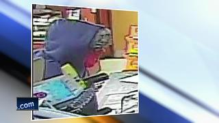 Police search for suspect in Fox Crossing robbery - Video