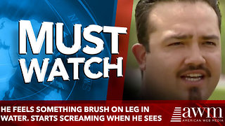 He Feels Something Brush on Leg in Water. Starts Screaming When He Sees - Video
