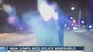Man jumps onto windshield of police cruiser on NYE - Video