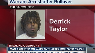Man arrested on warrants after rollover crash - Video