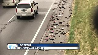 Shoes dumped on I-94 - Video