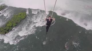 Wallenda hangs by teeth and feet from helicopter over Niagara Falls - Video