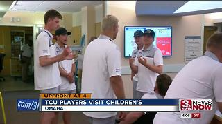 TCU players and coaches meet patients - Video