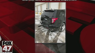 East Lansing police officer injured when patrol car rear-ended - Video
