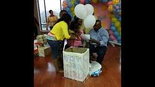 Expectant Parents Tear Up During Gender Reveal Party