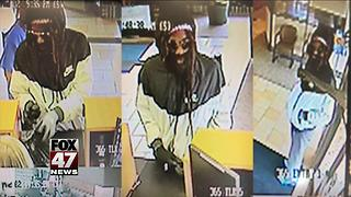 Police on look out for bank robbery suspect in Lansing - Video