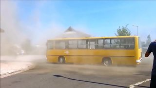 Driver pulls off epic drifts in 40-year-old bus! - Video