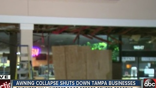 Awning in front of Tampa business collapses - Video