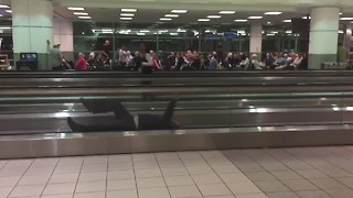 Man Hilariously Entertains Passengers During Airport Delay - Video
