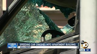 Speeding car crashes into apartment building