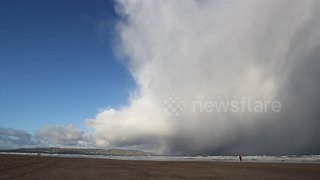 Huge winter storm cell over Northern Ireland beach - Video