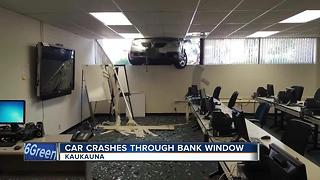 Woman accidentally crashes car into Kaukauna bank - Video