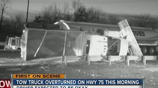 Sand truck flipped over on Highway 75 this morning - Video