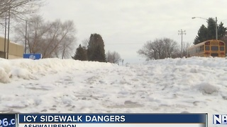 Icy, snow-covered sidewalks pose danger to handicapped - Video