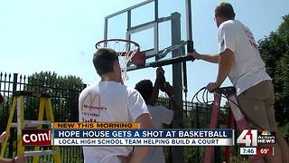 High school basketball team builds court for Hope House