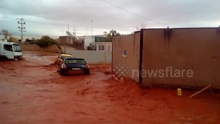 Flash floods sweep away vehicles in Greece - Video
