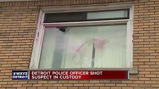 Suspect who shot police officer in custody - Video