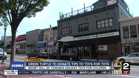 Green Turtle employees giving their tips to Tots
