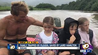 Surfer Laird Hamilton rescues family from flood - Video