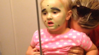 Girl Scared By Her Own Face Paint - Video