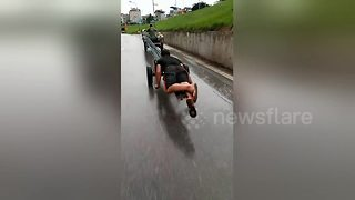 Man Uses Unconventional Method To Transport Metal Rods In Vietnam - Video