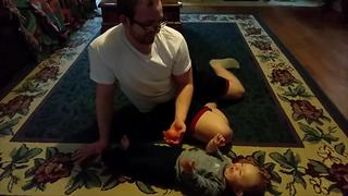 Adorable Baby Boy Laughs When His Dad Tosses An Orange - Video