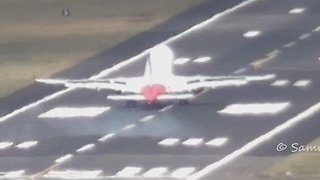 High Winds Cause Plane to Abort Landing - Video