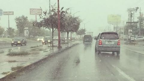 Cars Drive Through First Snow of the Season in Mexico