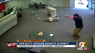 Off-duty officer shoots bank robbery suspect - Video