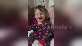 Baby can't stop laughing at the word 'booby' - Video
