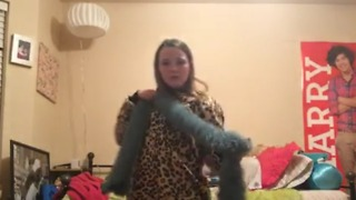 A Girl Falls Down Dancing With Her Christmas Presents