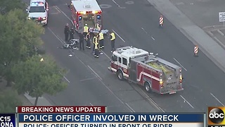 Man in serious condition after crashing into police car in Phoenix