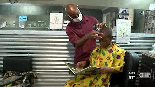 Local barbershop owner offers free haircuts and books to children