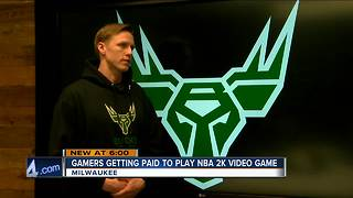 Gamers getting paid to play NBA game - Video