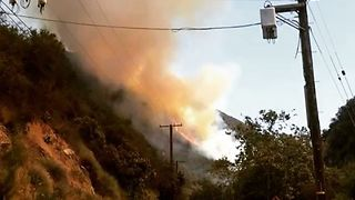 Brush Fire Spreads Uphill in Topanga Canyon, California - Video