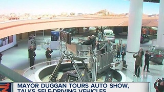 Mayor Duggan gets tour of auto show - Video