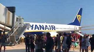 Ryanair Plane Evacuated After Mobile Phone Bursts Into Flames - Video