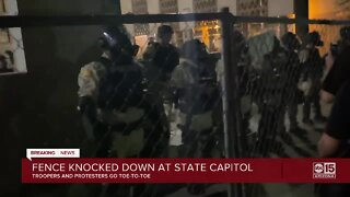 Group of protesters knock down fence at State Capitol
